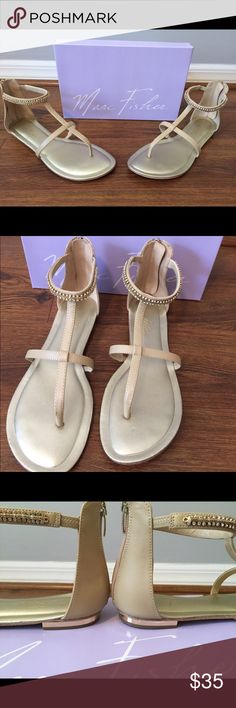 Nude Flat Sandal with Sparkle NEVER WORN, in perfect condition!!  Flirty and fun nude thong sandal with sparkly ankle strap.  Great shoe for vacations or day/night in the summer.  Works with all types of outfits!! Marc Fisher Shoes Sandals
