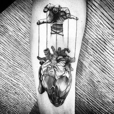 Gentleman With Heart Tattoo Pulled By Puppet Strings In Blackwork On Thigh