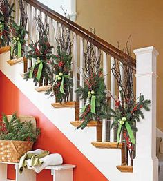 Holiday Decor that Lasts from Thanksgiving to Christmas: Step It Up- Tie bundles of bare tree and winterberry branches to the spindles in your staircase for an autumnal look. After Thanksgiving, tie pine boughs to the branches with a pretty velvet ribbon, and wire Christmas ornaments around the velvet ribbo