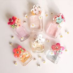 Marc Jacobs Daisy - i can't remember which scent i liked but i just know the cap has multicolored flowers