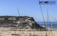 The charismatic beach houses at Monte Clerigo, Aljezur, in the western Algarve. Portugal
