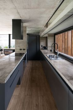 Luciano Kruk has completed a concrete house on the outskirts of Buenos Aires with a slatted wood entrance and a large swimming pool in its expansive garden. Kitchen Room Design, Modern Kitchen Design, Home Decor Kitchen, Interior Design Kitchen, New Kitchen, Concrete Kitchen, Concrete Houses, Luxury Kitchens, Home Kitchens
