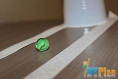 Capture the Marble activity - This game helps promote eye hand coordination and visual tracking/spatial skills.