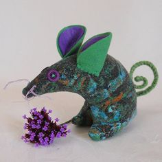 Looks like should talk & sing in a quirky Disney-ish fairytale retelling.   Retro Mouse  in Vintage Fabric 50s Aqua Green by audreyscat, £9.00