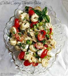 Chilled Caprese Tortellini Salad- cheesy pasta with a tangy dressing and fresh herbs and veggies.