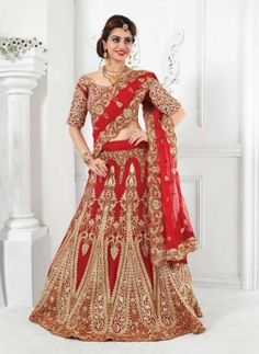 Red embroidered bridal wear Indian lehenga choli in net