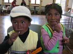 2012 NutriTour in Peru. Two children in Peru enjoying a treat.