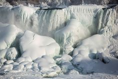 A partially frozen American Falls in sub freezing temperatures is seen in Niagara Falls, Ontario. Temperature dropped to -14 Celsius. The National Weather Service has issued Wind Chill Warning in Western New York from midnight Wednesday to Friday - Daily Telegraph on 19 Feb 2015