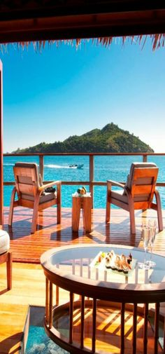 Likuliku Lagoon Resort, Fiji.  Over-the-water-bungalow.   ASPEN CREEK TRAVEL - karen@aspencreektravel.com