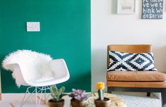 Cait Weingartner's Chicago Studio Tour // teal wall // pop of color // ikat accent pillows // white chair // photography by Stoffer Photography