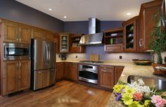 Hard wood floors and chrome accents...classy. #dreamkitchens #kitchens