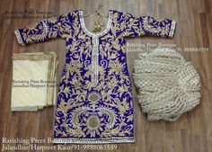 Purple colour shirt on pure silk base with heavy hand embroidery with full patiala salwar.