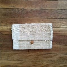 """Beige macrame woven clutch Small macrame woven clutch with wood bead closure.   10"""" x 6 1/2""""  Near mint condition. No rips, stain holes. Bags Clutches & Wristlets"""