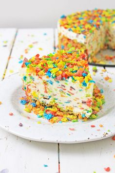 When you are in the mood for something fruity, nothing beats this Fruity Pebbles Cheesecake! Filled with cream cheese, fruity pebbles cereal and a whole lot of sugar, this is the sweet and fruity treat you need to get through the day! Fruity Pebble Cheesecake, Fruit Cheesecake, Pumpkin Cheesecake Recipes, Bon Dessert, Dessert Recipes, Desserts, Fun Recipes, Yummy Treats, Sweet Treats