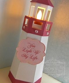 Interpret this to full size lighthouse with tall floor lamp