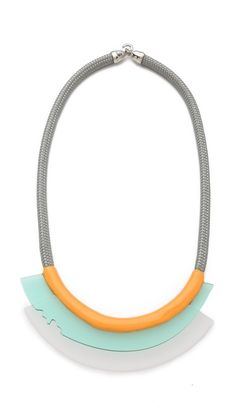 Orly Genger by Jaclyn Mayer Greta Necklace.  A long rope necklace makes a graphic statement with jagged-edged plexi panels and glossy enamel paint. Hook-and-eye clasp.