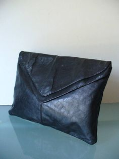 This bag is in wonderful condition. Very clean inside and out with no mentionable issues. It is a large envelope clutch which features 2 large compartments, one with zipper pocket. Measures 9x 13 Please measure carefully and feel free to ask more questions regarding size and condition