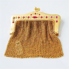 A MINIATURE GOLD MESH PURSE SET WITH DIAMONDS & RUBIES
