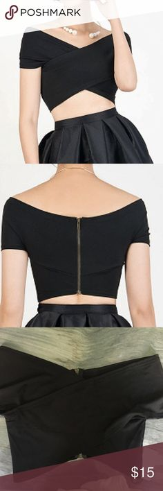 Off the shoulder crop Top in Black Stretch NWT.  Zip up back! Waist measurement is 13 in across. Tops