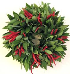 Bay leaves and chili peppers...perfect for Texas.  Use as a candle centerpiece.