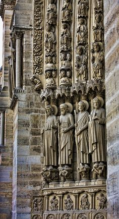 A portion of the facade of the Notre Dame Cathedral, Paris, France