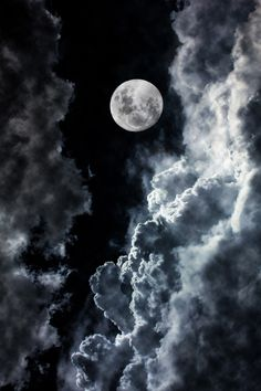 Magnificent shot of the moon with clouds.