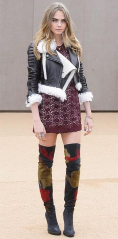 Cara Delevingne, clad in top-to-toe Burberry, brought her trademark downtown edge to the Burberry Prorsum fall/winter 2015 show when she took her seat in a shearling-lined moto jacket layered over a burgundy lace mini, complete with patterned thigh-high boots.
