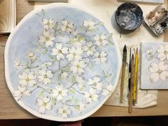 "www.lauriecurtis.net Unfired Maiolica painted Dogwood branch motif on 13"" terra cotta Platter by Laurie Curtis"