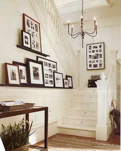 Love this white staircase with black and brown picture frame contrast - Home Decorating Magazines Gallery Wall Staircase, White Staircase, Gallery Walls, Gallery Frames, Brown Picture Frames, Picture Ledge, Picture Shelves, Black Frames, Wall Ledge