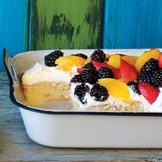 """We added whipped cream and fruit to a classic tres leches cake recipe to make it undeniably delicious. You can use any fruit in season, alone or in combination. This luscious dessert is named """"tres leches"""" -- """"three milks"""" -- because it's soaked in three different types of milk."""