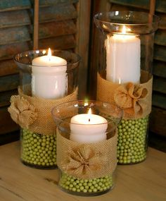 @Laura Gamble adorable DIY candle centerpieces... those beads are super cheap at Hobby Lobby!