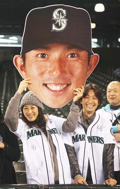 SEATTLE, WA - MAY 21: Fans hold a giant cutout of Munenori Kawasaki of the Seattle Mariners prior to the game against the Texas Rangers at Safeco Field on May 21, 2012 in Seattle, Washington.(Photo by Otto Greule Jr/Getty Images)    Favorite photo of the season so far.