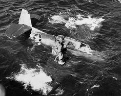 The crew of a TBF Avenger of Torpedo Squadron (VT) 31 scrambles from the sinking aircraft after the pilot ditched it during flight operations on board the light carrier Cabot (CVL 28) on September 6, 1943, sixty-nine years ago today.