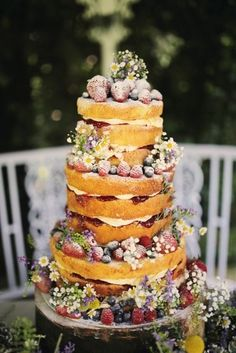 naked wedding cake with wildflowers - Deer Pearl Flowers / http://www.deerpearlflowers.com/wedding-cakes-desserts/naked-wedding-cake-with-wildflowers/
