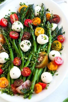 Asparagus Caprese Salad with Basil Gremolata recipe - An easy, 10 minute salad or side dish with fresh asparagus, mozzarella balls, and cherry tomatoes.