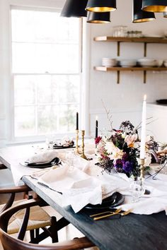 Cozy dinning space with casual table linens, simple tapered candles, and simple =wood chairs