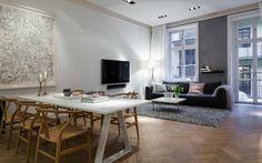 Skandinavisches Wohnung Design des Wohnzimmers mit Parkett und grauer Wand als Akzent