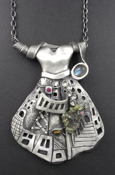 Hollow form, fine silver (PMC), labradorite, created ruby, created golden sapphire, semiprecious beads, sterling chain.
