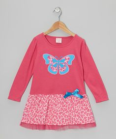 A wild cheetah print and touch of tulle at the hem score style kudos for this pretty frock. Comfy and carefree, its soft knit fabric is perfect for skipping across playgrounds.