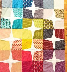 It's amazing how different a quilt pattern looks depending on your fabric choices! This is such a fun Rising Star Quilt!!