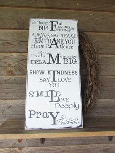 Rustic family rules sign.