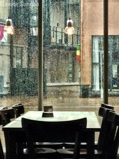 This is my perfect way to spend a rainy day.  Coffee, rain, my people watch or read a good book.