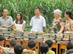 Two key volunteers were Xiaoling Mai, the lady in the white blouse, and her sister Xiaomin Mai by my side. Xiaomin is one of our board members and lives in Morehead, KY. Her two sisters, Xiaoling and Xiaoyuan arranged the book donations and dental clinic because one is a elementary school administrator and the other works at the hospital that brought the dentists.