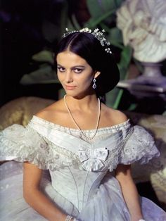 Claudia Cardinale in 'The Leopard' by Luchino Visconti, 1963. The character portrayed by Claudia Cardinale is the daughter of a crass nouveau riche man who has given his daughter the best upbringing money can buy. Angelica is still no aristocrat  Tosi knew exactly how to pitch his costuming - even the length of the pearl necklace is calculated to draw the eye downwards. Angelica is a prize beauty  she knows it.