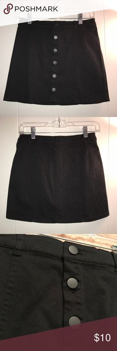 black button up mini skirt great condition, no permanent flaws but there are many tiny hairs and pills on it. selling because it is too big on me Forever 21 Skirts Mini