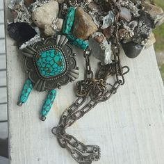 Vintage Park Lane necklace Vintage faux turquoise park lane silver tone necklace.  Silver plating on the Chain ha started to rub off has a pretty cool patina to it. Guaranteed lots of compliments  Missing one dangle bead as seen in pictures 3 with hallmark stamp Park Lane Jewelry Necklaces