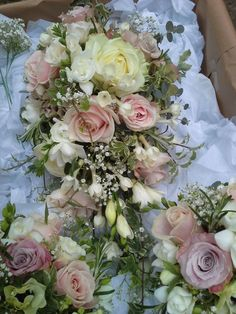 Trailing bouquet with sweet avalanche, avalanche roses, freesia and gysophila