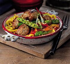 Sausage & Noodle Stir-Fry - Forget sausage rolls, wrap your hands around a bowl of meatballs and steaming noodles, pepped up with a sticky sauce of orange and soy Bbc Good Food Recipes, New Recipes, Recipies, Healthy Recipes, Sausage Meatballs, Pork Noodles, Pork Mince, Clotted Cream, Sausage Rolls