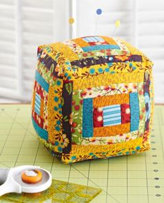 Free Pincushion Pattern Build a block from APQ would be so cute to make a series of blocks for baby in the family. Hours of visual stimulation from your stash! My Lazy Daisy Shop has lots of bright prints to choose from if you need more for your stash!