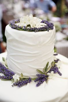 Topped with lavender and stephanotis, this wedding cake appears natural and fresh.